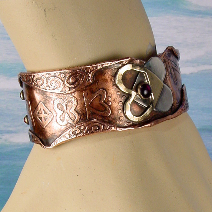 Front view of a beautiful engagement cuff on a model arm
